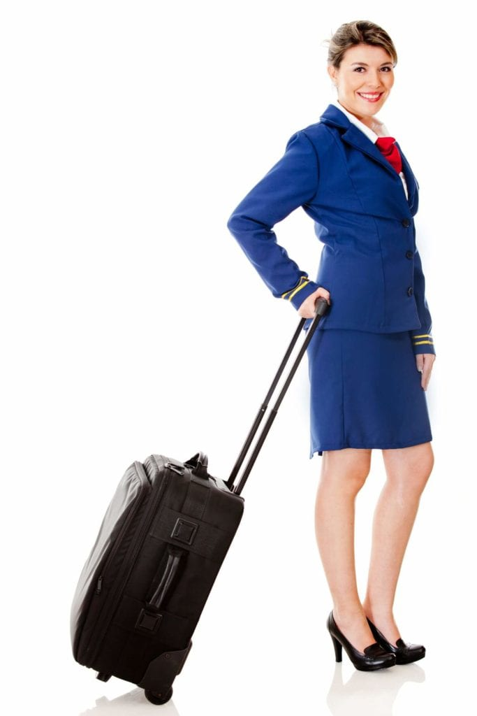 Become a flight attendant - women holding suitecase getting ready to board plane